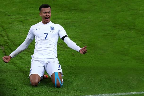 Dele Alli celebrates his spectacular goal on debut against France in November. Source: The Sun