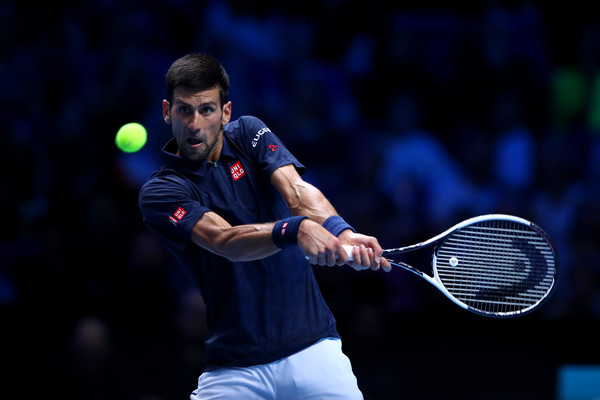 Djokovic competing in his first round robin match with Thiem on Sunday (Photo by Clive Brunskill / Getty Images)