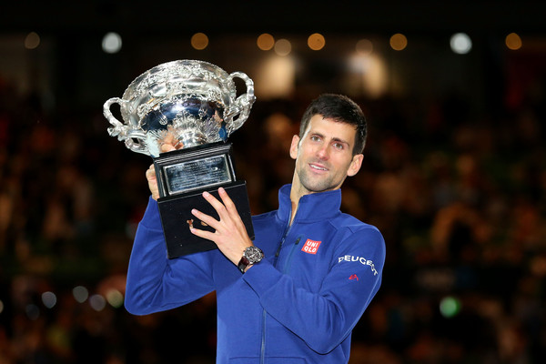 Djokovic posing witth the Norman Brookes Challenge Cup for a record-equalling sixth time after defeating Andy Murray in the final (Photo by Cameron Spencer / Getty Images)