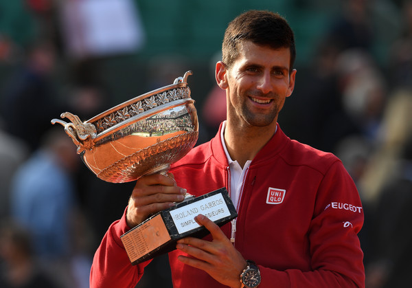 Djokovic holding his first French Open title back in June (Photo by Dennis Grombkowski / Getty Images)