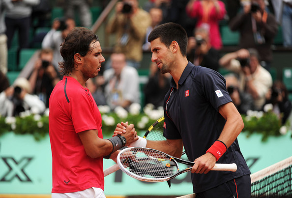 Nadal and Djokovic shake hands following their 2012 French Open final battle (Source: FameFlynet Pictures)