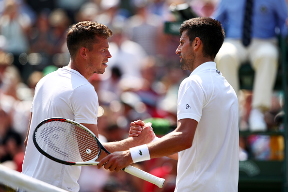 Djokovic and Pavlasek show respect for each other at the net after a good encounter (Photo by Clive Brunskill / Getty)