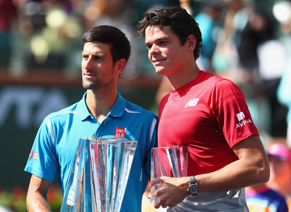 Djokovic and Raonic posing with their trophies following the conclusion of the final at the BNP Paribas Open in March (Photo by Julian Finney / Getty Images)