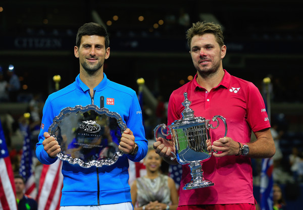Djokovic and Wawrinka holding their respective trophies following the conclusion of the US Open final (Photo by Chris Trotman / Getty Images)