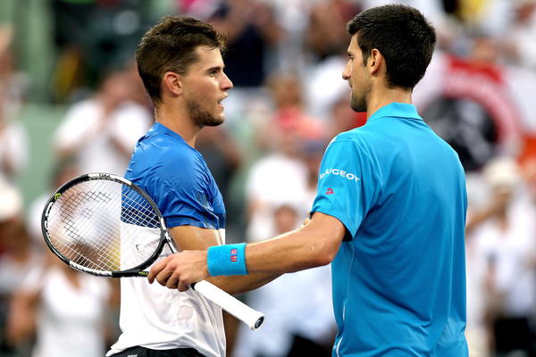 Thiem and Djokovic shake hands at the net following their fourth round encounter at the Miami Open (Photo by Matthew Stockman / Getty Images)