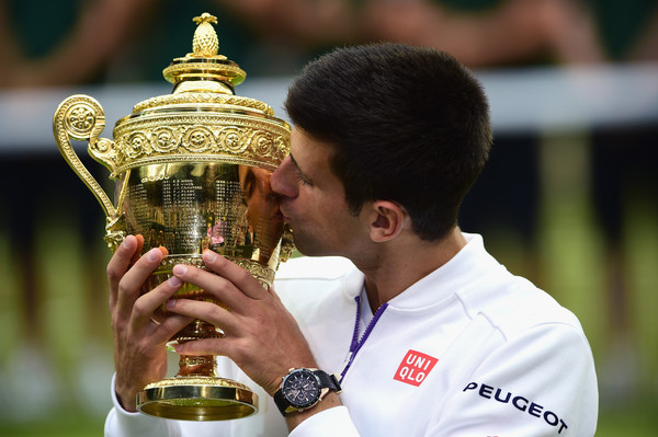 Djokovic kissing the Wimbledon Gentlemen's singles title following his win over Roger Federer last year (Photo by Shaun Botterill / Source : Getty Images)