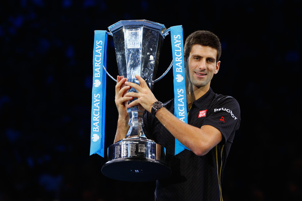 Djokovic holding the ATP World Tour Finals trophy in 2014 (Photo by Julian Finney / Getty Images)