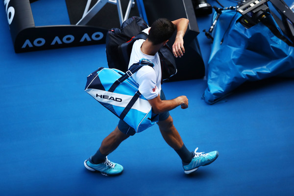 The five-time Australian Open champion cut a dejected figure in Melbourne (Photo by Clive Brunskill / Getty)