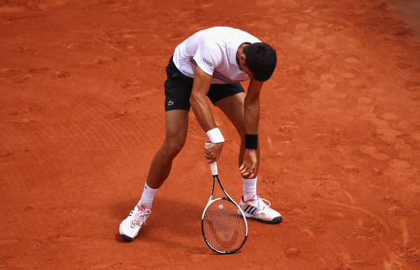 Djokovic looked like a defeated champion with no answers in his quarterfinal loss to Thiem in Paris (Photo by Clive Brunskill / Getty)