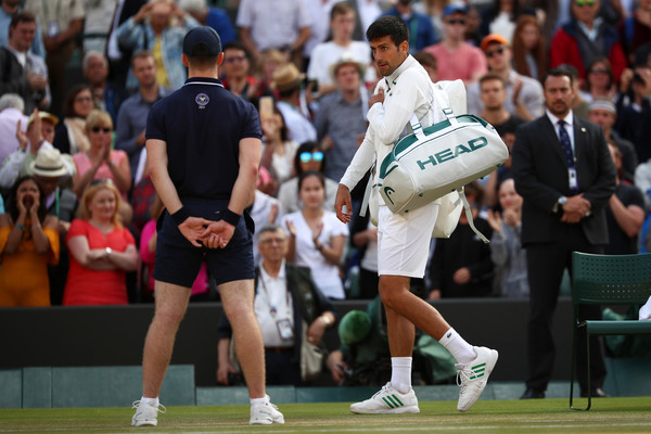The three-time Wimbledon champion was unable to finish his match against Berdych (Photo by Julian Finney / Getty)