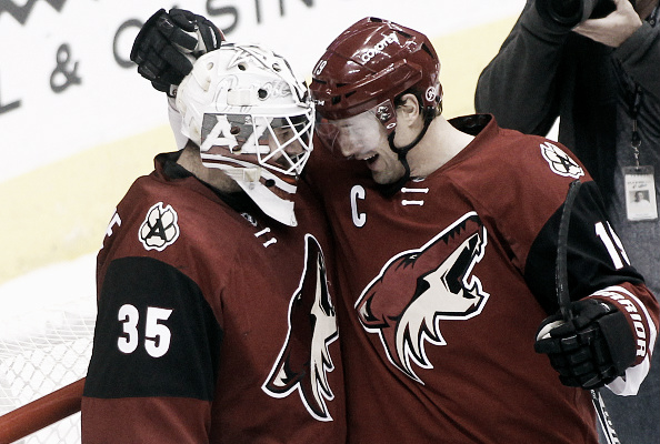 Goaltender Louis Domingue #35 and Shane Doan #19 of the Arizona Coyotes celebrate after a 5-1 victory against the Florida Panthers at Gila River Arena on March 5, 2016 in Glendale, Arizona. (Photo by Ralph Freso/Getty Images)
