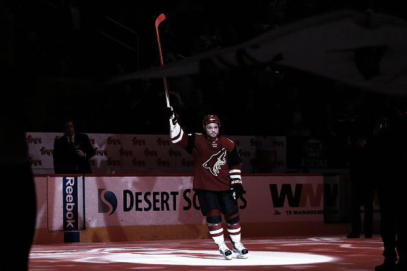 Max Domi #16 of the Arizona Coyotes waves to fans after being named the number one star of the game following the NHL game against the Edmonton Oilers at Gila River Arena on January 12, 2016 in Glendale, Arizona. The Coyotes defeated the Oilers 4-3 in overtime. (Photo by Christian Petersen/Getty Images)