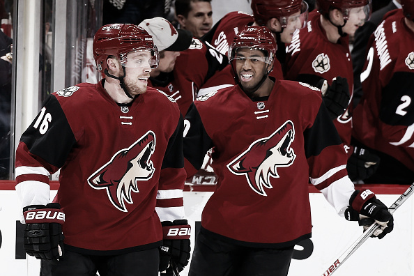 Max Domi #16 and Anthony Duclair #10 of the Arizona Coyotes celebrate after Domi scored a hat trick goal against the Edmonton Oilers during the third period of the NHL game at Gila River Arena on January 12, 2016 in Glendale, Arizona. The Coyotes defeated the Oilers 4-3 in overtime. (Photo by Christian Petersen/Getty Images)