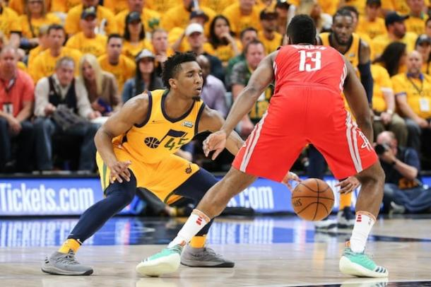 Utah Jazz guard Donovan Mitchell (45) defends against Houston Rockets guard James Harden (13) during the fourth quarter in game four of the second round of the 2018 NBA Playoffs. |Chris Nicoll-USA TODAY Sports|