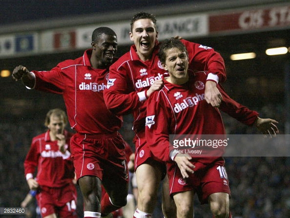 A fresh faced Downing (centre) celebrates with club legend Juninho during the club's cup winning season | Photo: Getty