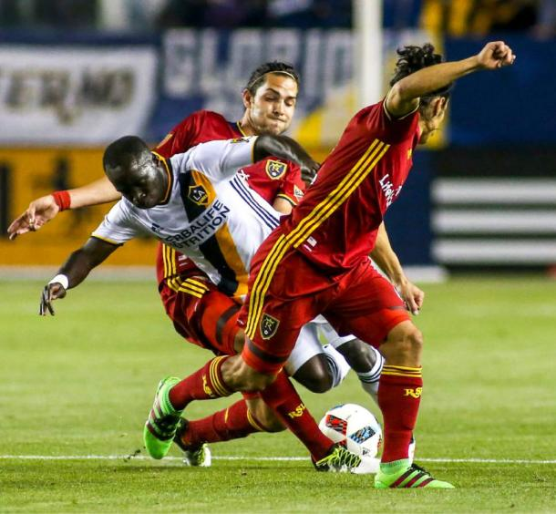 Two RSL defenders attempting to steal the ball away from Emmanuel Boateng (Center) on Saturday. Photo provided by AP Photo.