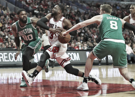 Dwyane Wade fighting through the Celtics defense  |  Getty Images