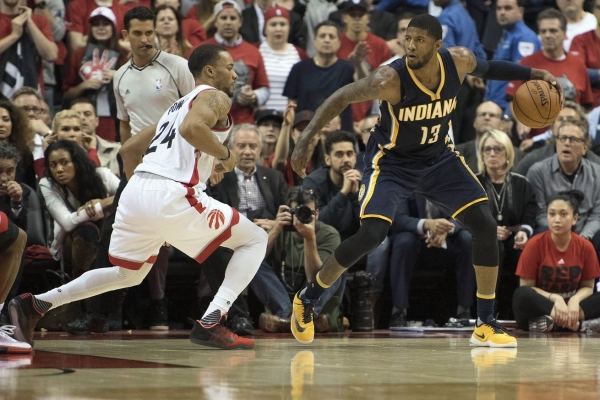 Pacers forward Paul George goes one-on-one with Raptors forward Norman Powell. Source: NBA Feeds
