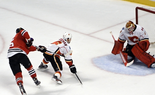 Brian Elliott needs to improve his game with the Calgary Flames. | Photo: USA Today Sports