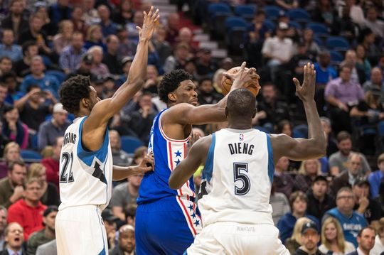 Joel Embiid (middle) gets double teamed in the post. PHOTO: Brace Hemmelgarn/USA Today Sports