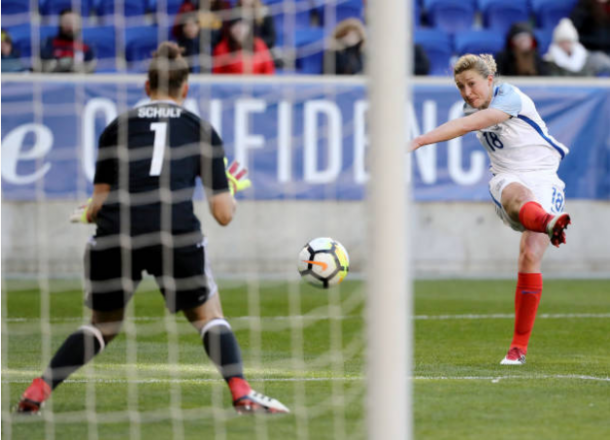 England attacker Ellen White takes a shot against Almuth Schult of Germany. She had a brace in the 2-2 draw. | Photo: Elsa - Getty Images