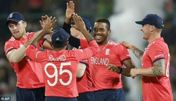 England, pictured celebrating a wicket against Sri Lanka, can still win the trophy (photo: AP)