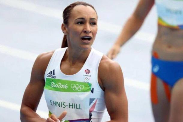Ennis-Hill glances to coach Toni Minichiello after her hurdle victory. | Source: BBC