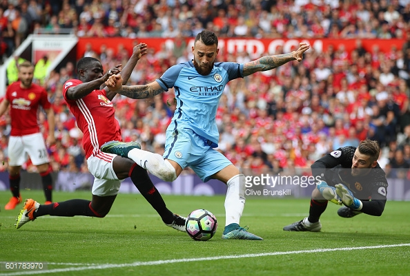 Eric Bailly tackles Nicolas Otamendi as he shoots at goal during the Manchester derby. | Photo: Clive Brunskill/Getty Images