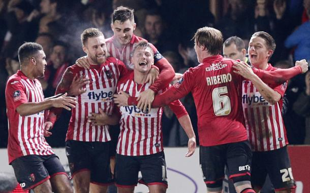 Exeter players celebrate their first goal (photo: getty)