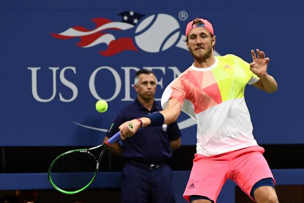 Lucas Pouille strikes a forehand at the US Open in New York City/US Open