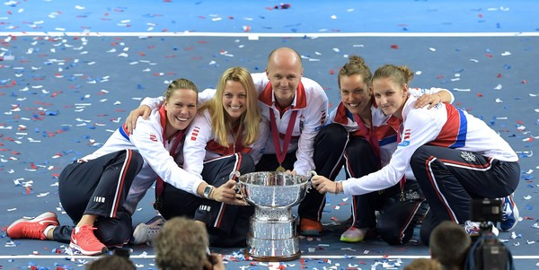 Kvitova and Pliskova along with their Fed Cup team celebrating their latest Fed Cup triumph in November (Photo by Patrick Hertzog / Getty Images)
