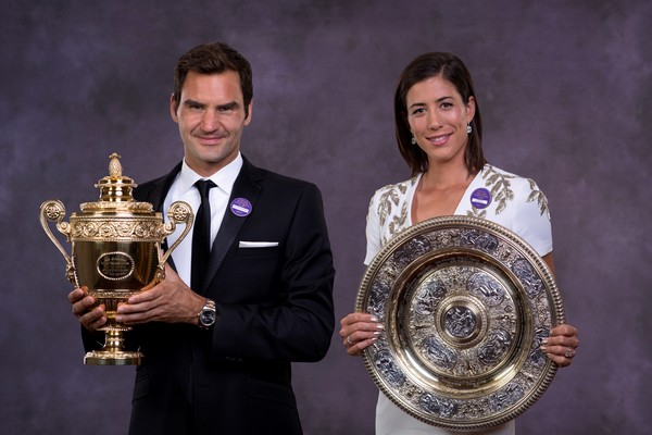 Federer (left) pictured with Muguruza (right) were on stage together for the Champions Dinner (Source: Pool / Getty)