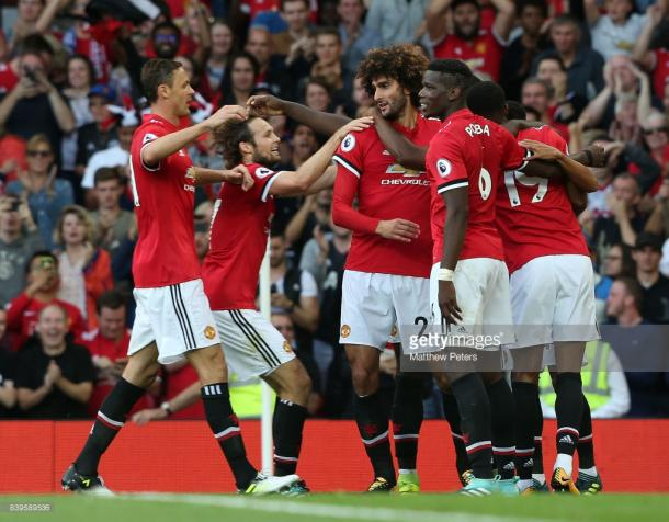 Manchester United, here celebrating Marouane Fellaini's goal against Leicester City, are off to a flying start.