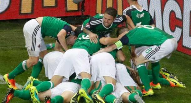 The Northern Ireland players celebrate McAuley's opener against Ukraine | Photo: Getty