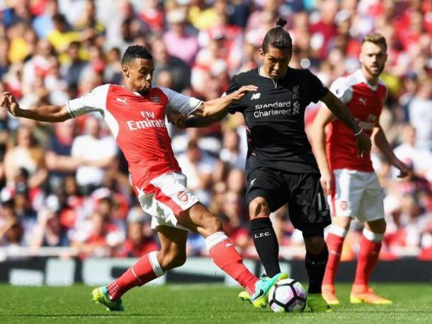 Roberto Firmino and Francis Coquelin contest for possession | Photo: Getty images