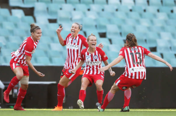 Melbourne City midfielder Jess Fishlock celebrates with her teammates after scoring the first goal of the Grand Finals match against Sydney FC. | Photo: Matt King - Getty Images