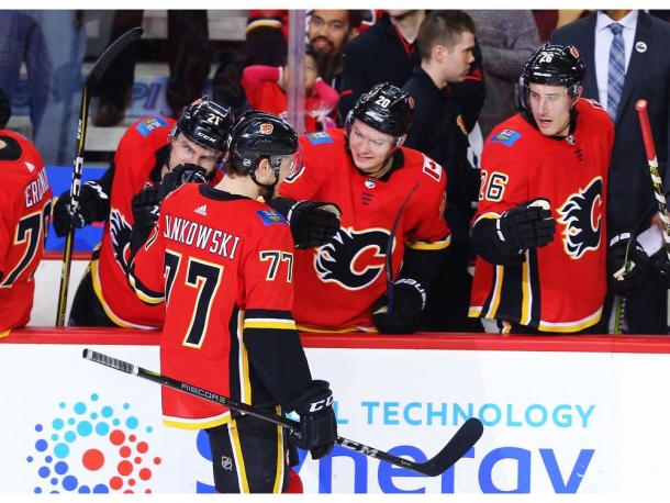 The Calgary Flames celebrate Mark Jankowski's four goal game. (Photo: Al Charest/Postmedia)