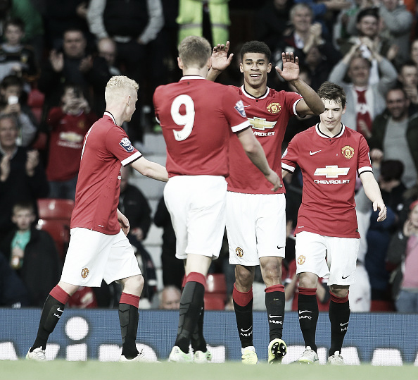 Fletcher (second right) celebrates during a youth team match at Old Trafford | Photo: Matthew Peters/ Manchester United