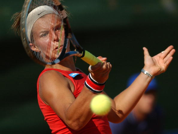 Flipkens representing Belgium in the Fed Cup in 2004 (Photo by Cristina Quicler / Source : Getty Images)