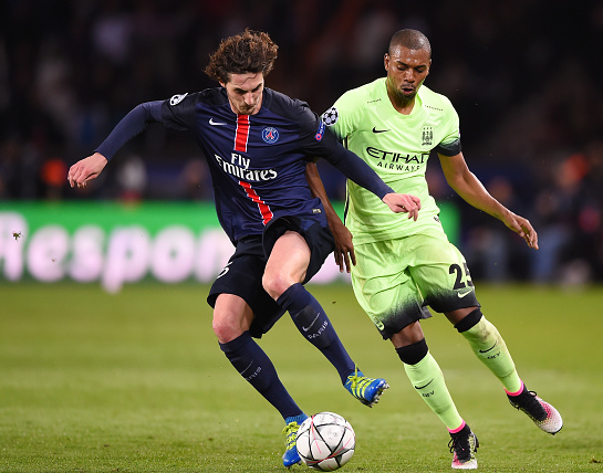 Midfield battle: Rabiot and Fernandinho vying for possession. | Photo: Getty Images