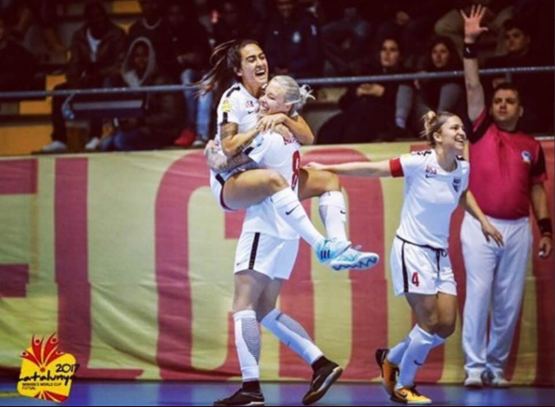 McKenzie Berryhill lifts her teammate in celebration after the USWNFT wins their match against Australia 6-2 to advance to the quarterfinals of the AMF Futsal Women's World Cup | @MLFUSA