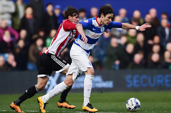 Angella (pictured, right) in action for QPR back in March of this year. | Photo: Getty