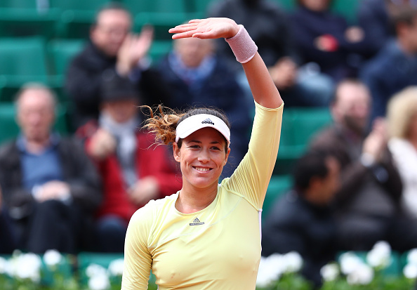 Muguruza salutes the crowd after her comeback. Photo: Julian Finney/Getty Images