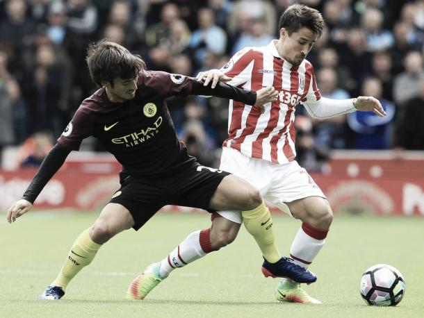 David Silva and Bojan battle for the ball. Photo: Getty.