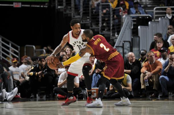 Kyrie Irving goes for a steal against DeMar DeRozan (David Liam Kyle/NBAE via Getty Images)