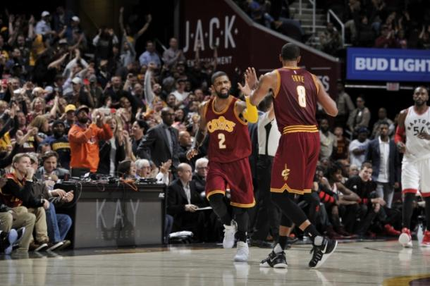Channing Frye and Kyrie Irving celebrate during the Cavaliers' win over the Raptors (David Liam Kyle/NBAE via Getty Images)