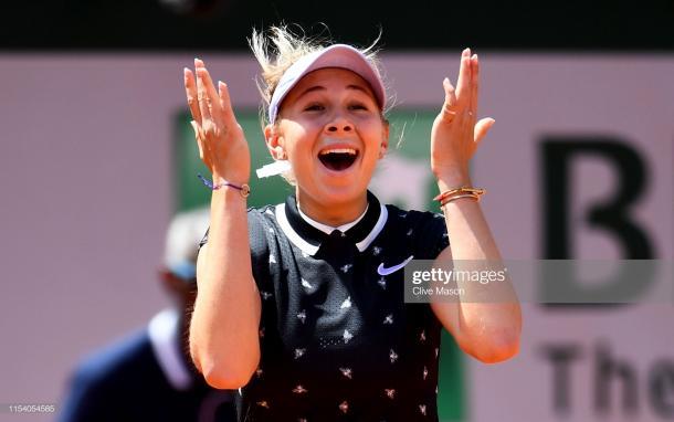 Anisimova celebrates her win over Simona Halep (Getty Images/