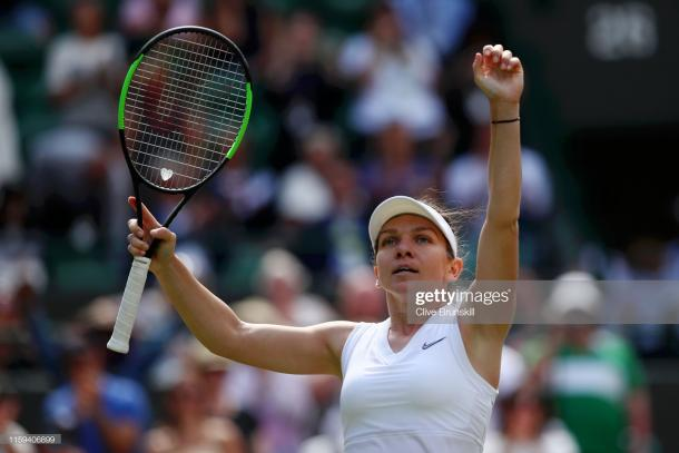 Simona Halep celebrates her first round victory over Aliaksandra Sasnovich (Getty Images/Clive Brunskill)