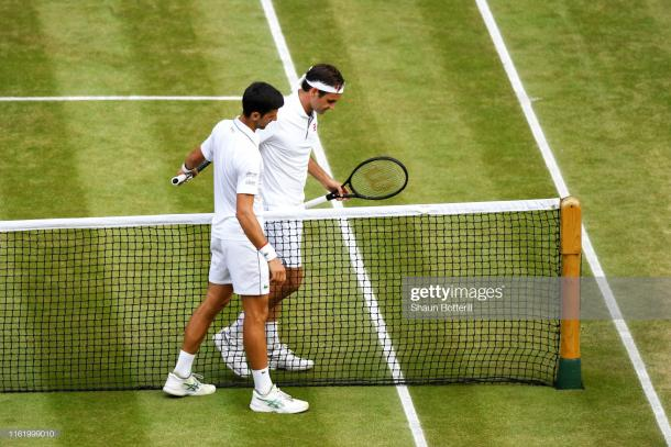 The two great champions embrace at the net (Image source: Shaun Botterill/Getty Images)