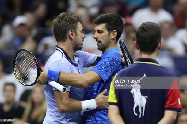 Wawrinka consoles Djokovic after the Serb was forced to retire/Photo: Matthew Stockman/Getty Images